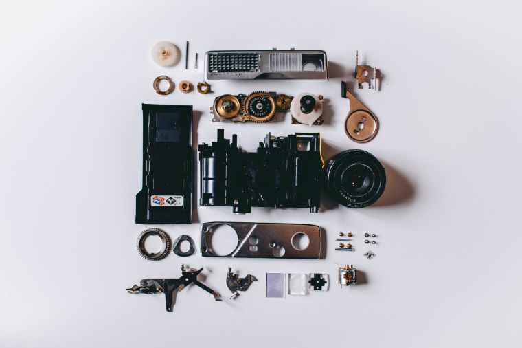 flat lay photography of parts of camera